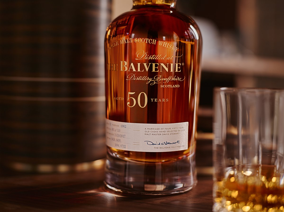 The Balvenie Fifty next to glass and custom bottle holder