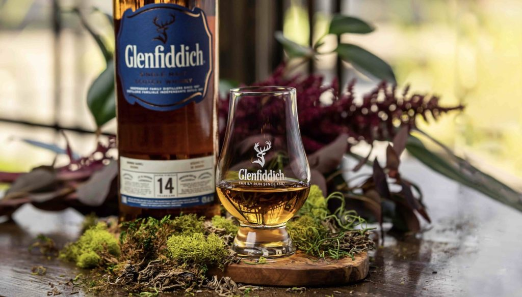 Glenfiddich 14 year reserve bottle and glass on table